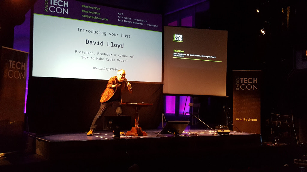 David Lloyd performing a lunge on stage as he opens Radio TechCon 2016
