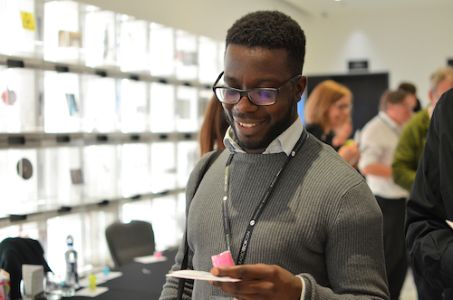 Male TechCon delegate collecting his pass