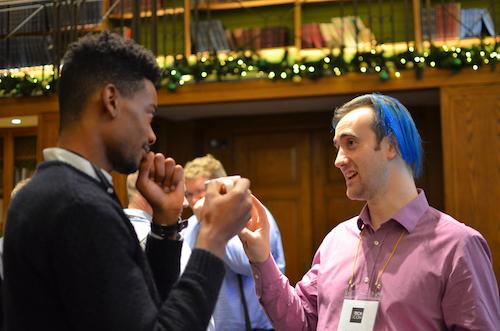 Two male delegates chatting during Radio TechCon 2017